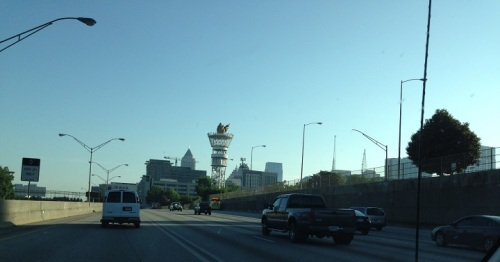 Downtown Atlanta, with the Olympic Torch towering above Centennial Park . . .