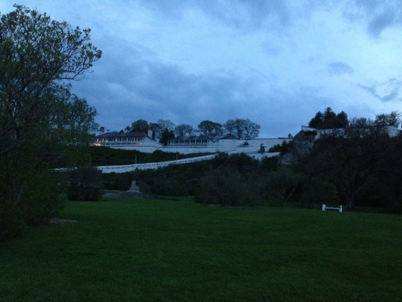 Fort Mackinac against a slowly darkening sky.