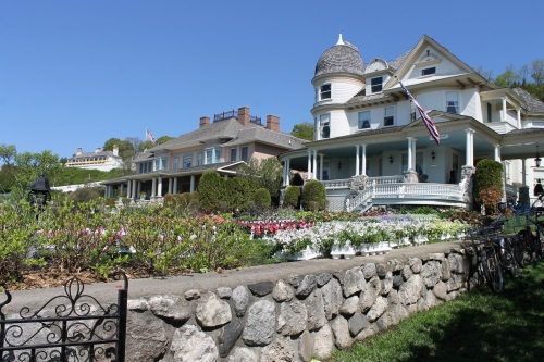 Imagine watching dray after dray of annuals pass on the street and stop at cottages to drop off their summer gardens.  Here, Brigadoon and St. Anne's Cottage lawns are filled with flowers to be planted later in the day.