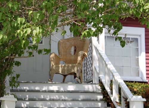Loved this almost-hidden wicker chair on someone's front porch.  Great place to people watch!