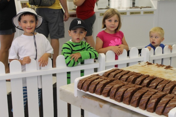Amazed children watch the fudge makers in Original Murdick's Fudge.