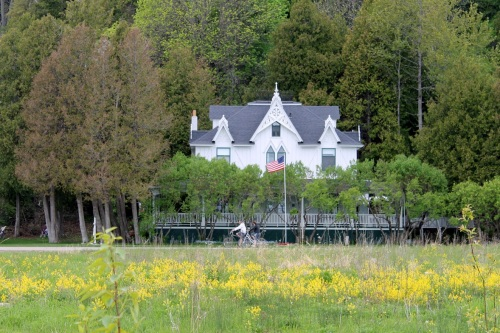 Beautiful Small Point Inn - looking like a gingerbread house peeking out over the lilacs.