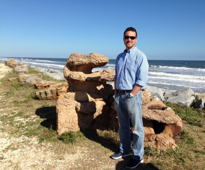 Blake with a huge piece of the coquina rock responsible for the cinnamon-colored beaches in our region of Florida.