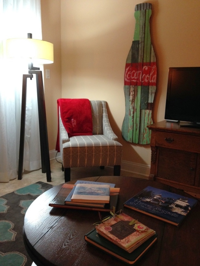 There are a lot of Mackinac memories in this room - the art over the couch by Richard Wolfgang, a much-loved friend who recently passed away, several Mackinac coffee table books, and tons of photo albums loaded with pics from our years on the island.  The coke bottle was a gift from son Jason last Christmas.  Coca-Cola began in Georgia, and he wanted us to have something we could see everyday to remind us where our roots are.