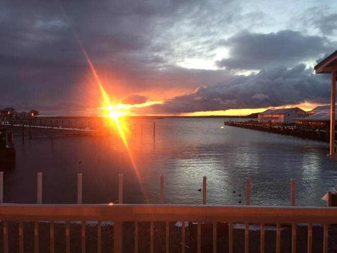 The sun as it rose over the breakwall this morning - as seen from the Chippewa Hotel.  (Photo:  Josh Carley)