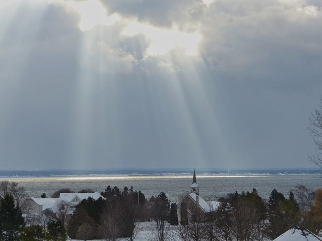 An awesome photograph of the sun's rays breaking through the clouds over the island - God's light.  (Photo: Robert McGreevy)