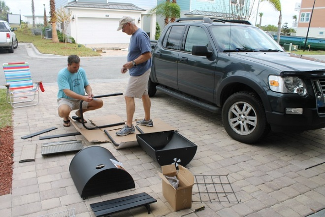 We're also learning how nice it is to have a bonus son living nearby . . . like when he volunteered to help Ted put together our new grill!